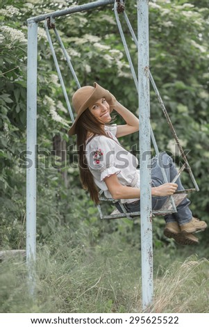 Young girl relax outdoors, toned image