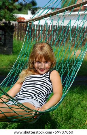 young girl relaxing in hammock - stock photo