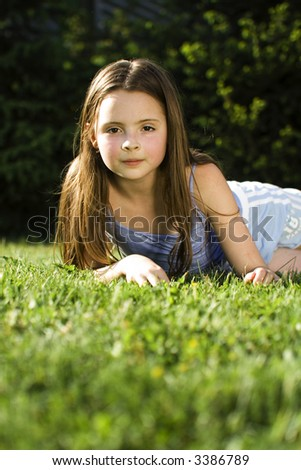Young girl relaxing on grass
