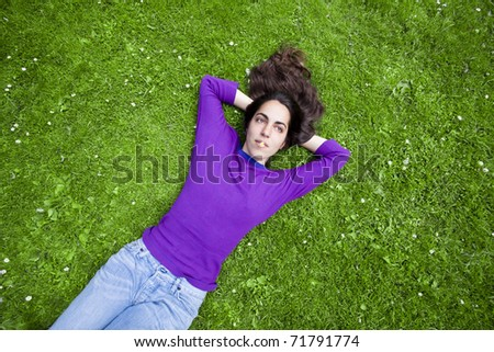 young girl relaxing on the grass
