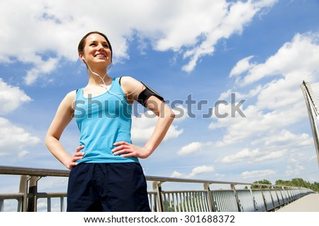 Young girl rest after running. Over sky smiling. - stock photo