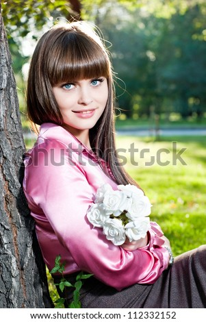 Young girl resting in the park - stock photo