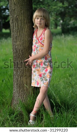 Young girl resting in tree