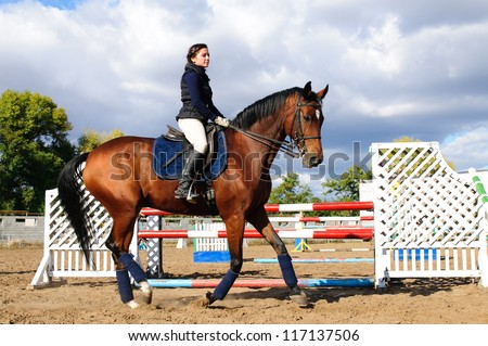 Young  girl riding running horse - stock photo