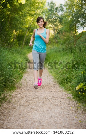 Young girl running in nature