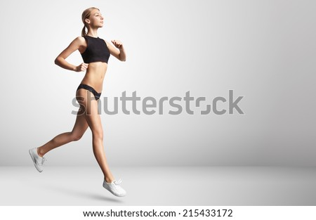 young girl running indoor - stock photo
