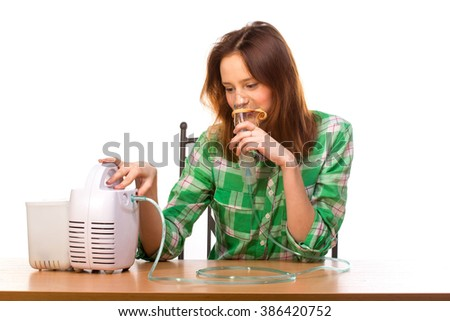 Young girl running nebulizer mask for respiratory inhaler Asthma Treatment isolated on a white background. Close up view. - stock photo