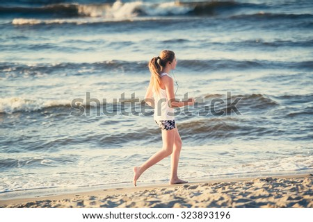 Young girl runs In the Baltic Sea