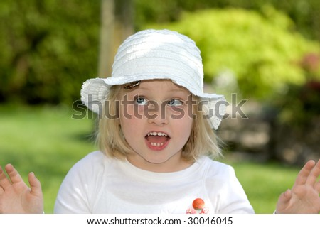 Young girl scared of a chafer beetle - stock photo