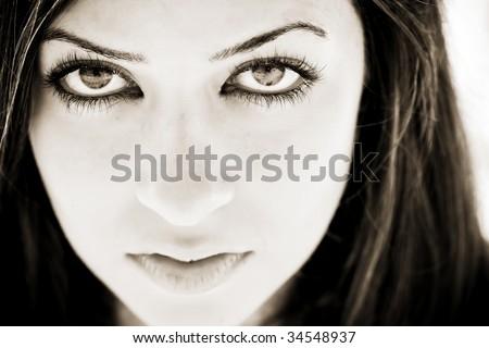 Young girl sensually staring at camera - stock photo