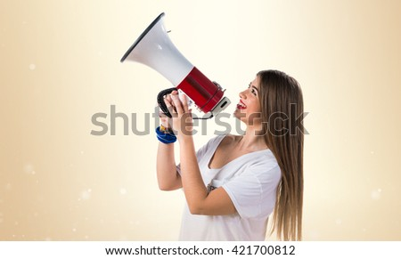 Young girl shouting by megaphone