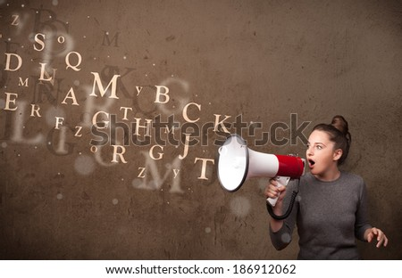Young girl shouting into megaphone and abstract text come out - stock photo