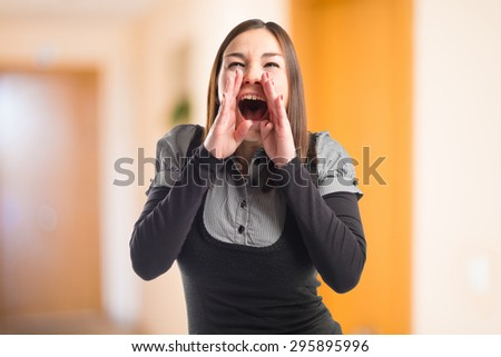Young girl shouting on unfocused background