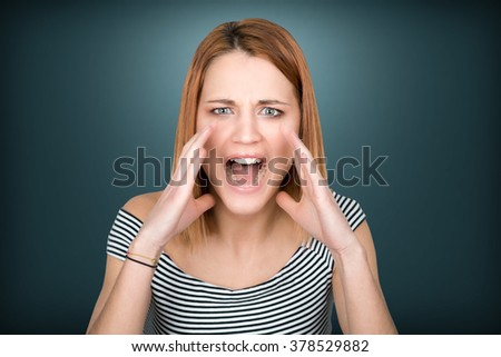 Young girl shouting with both hands and open mouth