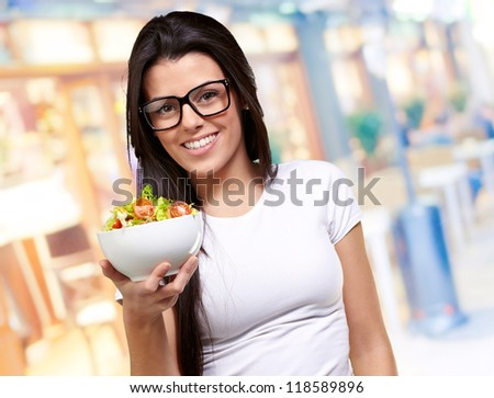 Young Girl Showing A Bowl Of Salad, Outdoor