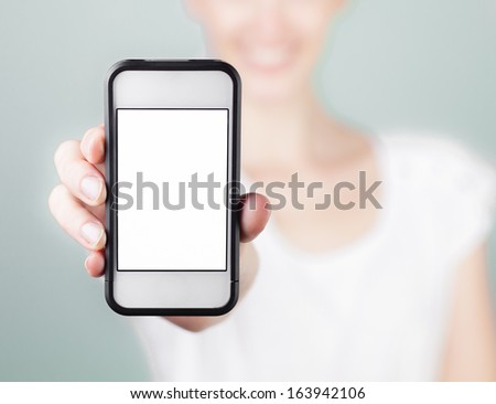 Young girl showing blank mobile smart phone - stock photo