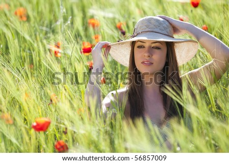 Young girl showing her elegance on a green field. - stock photo