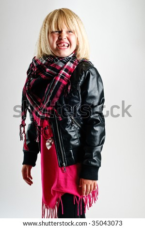 Young girl showing her new cloths, in a fashion way - stock photo