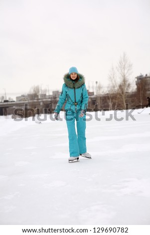Young girl skating on the frozen lake