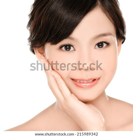Young girl Skin care and her touch health face - stock photo