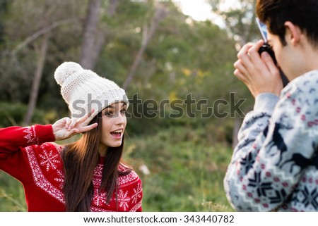 Young girl smile while a friend take a photo with camera