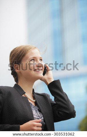 young girl smiling and talking on the phone
