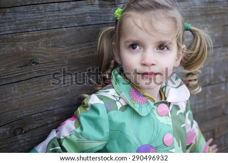Young girl smiling at the camera - stock photo