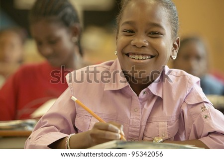 Young girl smiling in classroom