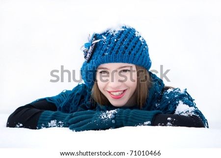 Young girl smiling in winter clothes - stock photo