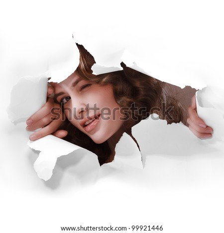 young girl smiling winking with one eye tearing white paper wall breakthrough design element template - stock photo