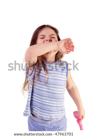 young girl sneezing into her arm, isolated - stock photo