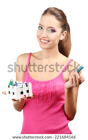 Young girl sorting battery isolated on white - stock photo