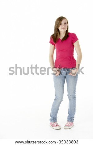Young Girl Standing In Studio - stock photo
