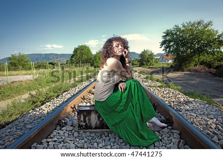 Young girl standing on a railway