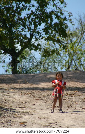 Young Girl Standing on Path - stock photo