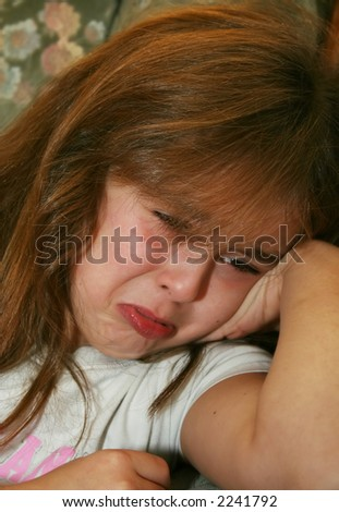 young girl starting to cry - stock photo