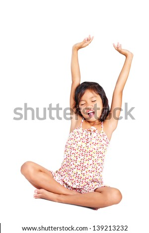 Young girl stretching her arms upon waking up. - stock photo