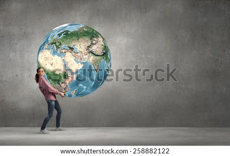 Young girl student carrying Earth planet. Elements of this image are furnished by NASA - stock photo