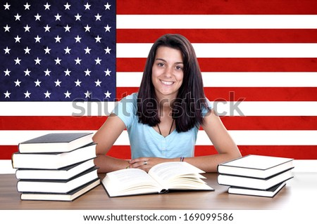 young girl student pc on the background with American flag. English language learning concept