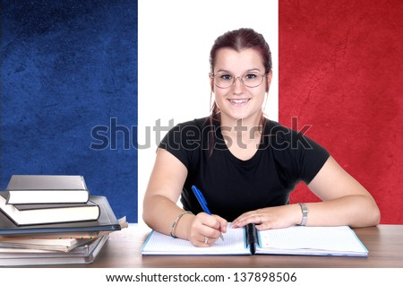 young girl student pc on the background with french national flag. french language learning concept - stock photo