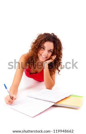 Young girl studying - isolated over white background - stock photo