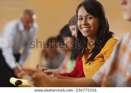 Young Girl Taking Notes - stock photo
