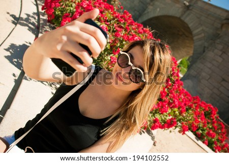 Young girl taking selfie. - stock photo