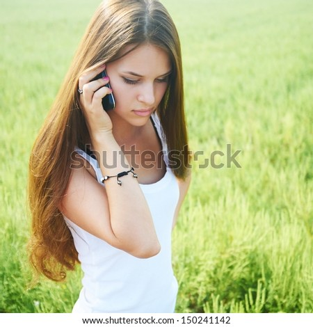 Young girl talking on the phone. - stock photo