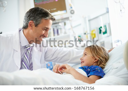 Young Girl Talking To Male Doctor In Intensive Care Unit - stock photo