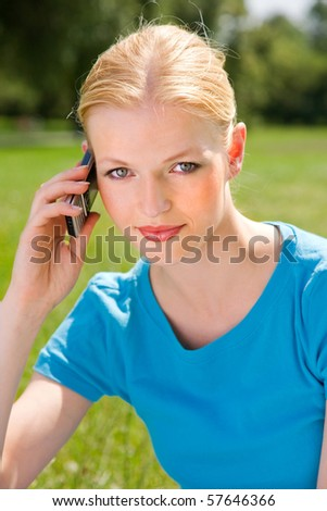 Young girl talks on the mobile phone