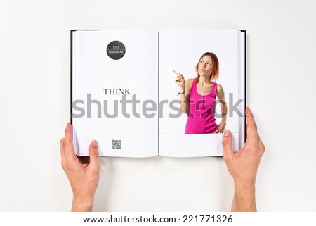 Young girl thinking printed on book - stock photo