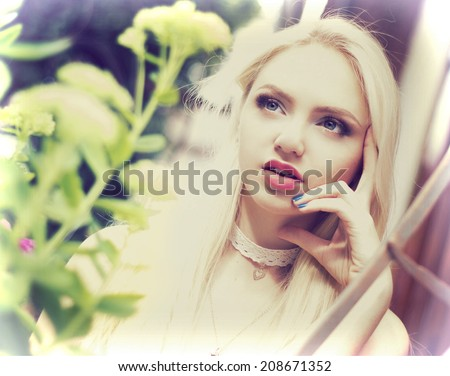 young girl touching hands to face - stock photo