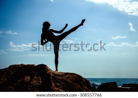 Young girl training karate - stock photo