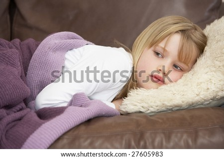 Young Girl Unwell Lying On Sofa